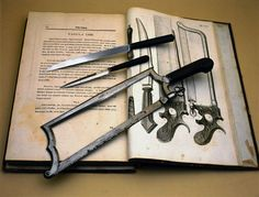 A set of amputation instruments, including a saw, shown laid across an illustrated plate from an early surgical textbook written by Giovanni Alessandro Brambilla (1728-1800). Brambilla was military surgeon to the Austrian Emperor Josef II. His treatise represented a landmark in surgical textbooks. The instruments are made of steel and ebony, and were manufactured by Lichtenberger in Strasbourg, c 1800.    Image number:  10288827  Credit:  Science Museum/Science & Society Picture Library