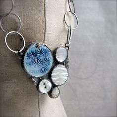 sterling necklace with vintage buttons and porcelain cab