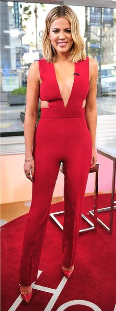 Khloé Kardashian in a sexy red cutout jumpsuit - click through to see her style evolution over the years