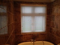 50mm White Wooden Venetian Blind Installed In Bathroom