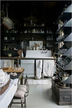 Shelves, aesthetically pleasing and probably added stability for weight. Always love dark and mad scientist elements in a kitchen, who knows what might get cooked up there!