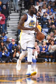 Draymond Green of the Golden State Warriors handles the ball against the Philadelphia 76ers on November 11 2017 at ORACLE Arena in Oakland California...