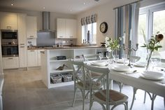 Interior designed kitchen / Dining room with a beach / seaside feel to it. Love the French Camargue Chairs in chalk white and the white wood french dining table. Reclaimed Oak effect floor. Redrow Homes 2014 Kitchen Family Rooms, New Kitchen, Kitchen Decor, Kitchen Ideas, Open Plan Kitchen Dining Living, Dining Room, Dining Table, Redrow Homes, Kitchen Diner Extension