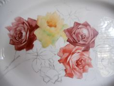 Painting a platter with roses
