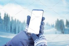 Ad: Smart phone in hands with gloves by RSplaneta on @creativemarket. Smart phone in hands with gloves. Concept of using a mobile phone to plan a hiking route. Mountain with snow in background #creativemarket Technology Photos, Hiking Routes, Business Branding, Infographic, Smartphone, Gloves, Mountain, Hands, Concept