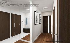 Projekt przedpokoju Inventive Interiors - lustrzana szafa w przedpokoju, grafiki w korytarzu