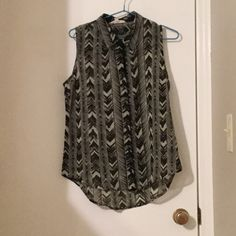 Black and Tan tribal print sleeveless button up Black and Tan tribal print. Sleeveless and sheer button-up with collar. Worn once, like new condition. Olive & Oak Tops Tank Tops