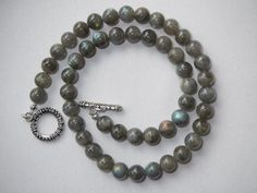 Gorgeous high quality LABRADORITE necklace with amazing blue sparks.  Uniform 8mm diameter beads, total length 17 inches, Tibetan silver (pewter like) toggle clasp  Ships in giftbox.