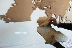World Cork Map. 10 mm cork on adhesive film 3M It easy to place this cork map on the wall. Cork map has side special sticky layer 3M. Cork map consist of 70 cork stickers(continents and islands). Set cardboard templates for correct installation are applied. Each element and its place in the template are numbered. The size of the parcel: 1050*850*100 mm Cork World Map, Cork Map, Cardboard Crafts, Home Wall Decor, Continents, Islands, Adhesive, How To Apply, Templates