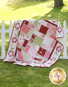 Flannel Rose Rag Quilt Kit: **Due to the bulk of this product, additional shipping charges may apply for international customers.** Pre-fused laser-cut applique flowers surround the soft, fluffy ragging on this lovely flannel quilt. This lap-size quilt finishes to approximately 55