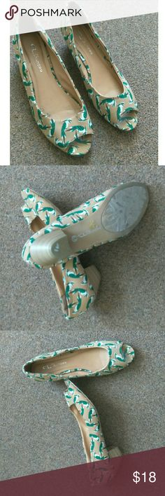 Chinese Laundry Home Run Shoes Green Cute and definitely has a retro inspired look to it. These shoes by Chinese Laundry are called Home Run.  Slip on with an open toe. Small 1-2 inch heel. Great Condition. Size 8.5 Chinese Laundry Shoes