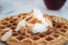 Pumpkin spice waffles with caramelized almonds and homemade whipped cream | A Girl in LA