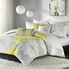 Lola is the perfect solution to an updated, modern print look.  This duvet collection features an overscaled floral print design printed on 100% cotton fabric for a super soft hand feel.  The reverse of the duvet is a soft white color that coordinates with the grey, white and yellow from the face of the duvet.  The decorative pillows feature embroidery and piecing details.