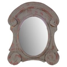 Wall mirror with a weathered frame and scrolling detail.  Product: MirrorConstruction Material: Wood and mirrore...