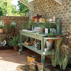 Potting bench - like the entension on the end with round holes to hold pots you are working on.