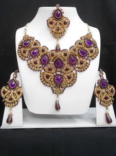 The Very Exclusive Indian Patwa Jewelry sets available with matching pair of earrings and mangtikka. The speciality of this jewelry set is its gorgeous looks which is beatifully handcrafted work with high quality Cubic Zirconia (CZ) stones and the beads o