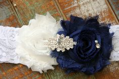 This gorgeous handmade blue lace bridal garter is embellished with a stunning rhinestone and pearl brooch. Beautiful finishing touch to your special day! This garter is made with 2 inch wide stretch lace. http://www.etsy.com/shop/TheWeddingDivas