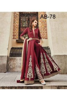 Wearing one color is anything but boring! You know you've done it on lazy days. An easy—and often stylish—way to wear outfits is to stick to monochromatic pieces. Go classic head-to-toe in this Indiwear embellished singular tone maroon top and pant combo. Salwar Suits Simple, Patiyala Dress, Salwar Suits Party Wear, Trendy Suits, Western Suits, Fancy Suit, Indian Clothes Online, Designer Salwar Suits, Fashion Sale