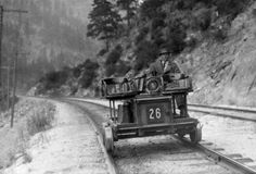 E. B. Allison operates Western Pacific track inspection motor car No. 26, in Feather River Canyon, California. c. 1909