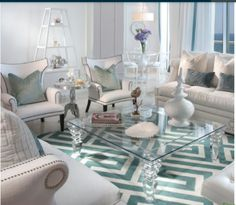 Traditional pieces mix with a coastal color palette to create a beachy glam sitting area.
