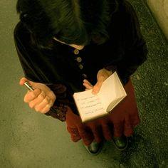 Audrey Tautou as Amélie Poulain who's looking for Dominique Bretoteau.