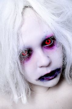 ,,,purple around eyes with red contacts. creeeeeepy good