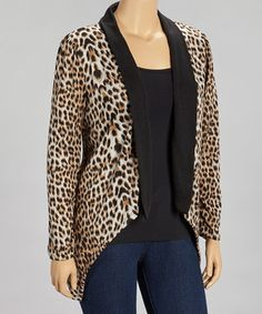 A fierce feral print takes this charming cardigan from staple to standout. With its lively leopard spots, fluttery sidetails and stretch from spandex, this pretty piece flaunts flirty fashion while maintaining a sophisticated look.