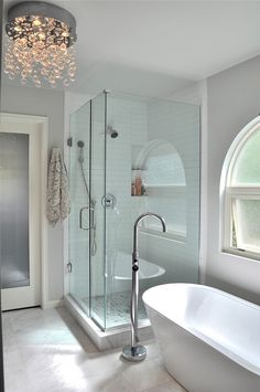 Waterfall crystal chandelier by ET2, Frameless shower and stand alone tub!