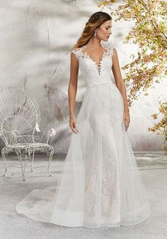 Delicate and Romantic, this Chantilly Lace Wedding Dress is Accented with Venice Lace Appliqués and a Full Tulle Skirt Overlay. A Stunning Keyhole Back Trimmed in Covered Buttons Completes the Look. Available at The Princess Bridal in Spring, TX. Mori Lee Bridal, Mori Lee Wedding Dress, Fairy Wedding Dress, Tulle Wedding, Bridal Wedding Dresses, Wedding Dress Styles, Designer Wedding Dresses, Keyhole Wedding Dresses, Boho Wedding