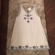 """Embroider tunic Sleeveless white tunic/dress with blue embroidery. Beautiful gauze fabrication with attached lining. Shoulder to hem 30"""" En Creme  Dresses Mini"""