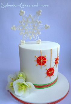Contemporary Christmas Cake with quilled gumpaste snowflake and rice paper Helleborus.