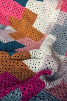 Detail of crochet granny squares in cross pattern blanket