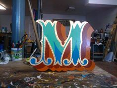 Gold West Sign Arts .... typography letter M