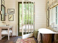 As close to the outdoors as you can get, this bathroom is complete with nickel-plated deep soaking tub and an oversize door (with a screen) to help connect with nature. Great way to relieve some stress.