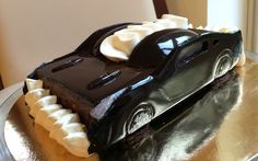 Chocolate handmade cake copying Nissan GTR car. All the decoration are pure dark chocolate covered with the chocolate glaze.  Inside is the brownie cake with banana and dark chocolate creme.