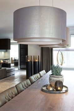 Like the stand alone pots by the curtains - adding drama and height to an otherwise ordinary and unused space...