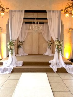 we have a chuppah or gazebo like this, but would make the white draping cover more of the dark wood and would not put flowers on the uprights, but would rather gather then with a simple wide ribbon (No bow)