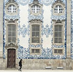 How beautiful is this church in Portugal?  In the 16th century, the King banned imports of Delft from the Netherlands, so local artists went to town and painted all of these tiles called Azulejo.  @afarmedia - lots of great pics! . . .