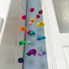 Handmade felt floral rainbow mobile (or suncatcher!!) 20 flowers each one a different colour. Featuring daffodils, roses, forget me nots, daisies and marigolds. I really love this one each none handmade to order so you can customise your colours and flowers Available at www.anniemadeit.com