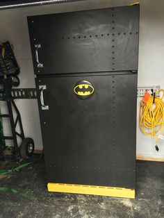 The bat-fridge BEFORE. See AFTER pics. Once was an average white fridge with rust and now looks awesome. Yes you can write on it with chalk, yes the interior has also been painted to match exterior! FOLLOW ME!