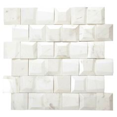 """Geometric Volakes White Marble Mosaic Tile in 3-D Pattern Lavish yourself and indulge in this white geometric pattern mosaic tile. White marble in individual pieces approximately 1.875"""" x 1.875"""" form an irregular square pattern. Create a statement with this ultra modern tile on a backsplash, fireplace surround, shower and this will look stunning on a feature wall as well. The mesh mounted sheet makes it easy for installation and the tightly knit pattern does not require grouting. Size… Pool Mosaic Tiles, Marble Mosaic, Mosaics, Tile Around Tub, Fireplace Surrounds, Tile Fireplace, White Tiles, White Marble"""