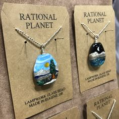 Rational Planet uses lamplight to cure their pendants and zipper pulls. Holiday Market, Zipper Pulls, How To Make Beads, Lampwork Beads, Cure, Gift Guide, Turquoise Necklace, Glass Beads, Bling