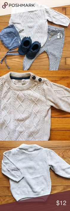 ❄️ Takes One To Snow One Sweater Heathered oatmeal cotton-mix sweater with two buttons at neck. Cable knit on front and arms.  • Size 6-9mo, but has a loose fit to it. • Excellent gently worn condition. • Bundle 3 or more items and receive 20% off! H&M Shirts & Tops Sweaters