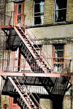 Apartment Building Fire Escape Ladder red brick, fire escape ladder, sign, no parking, new york, balcony