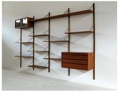 Poul Cadovius unit. I have two walls I'm considering one of these for. The fine folks from Golden Age Design thought I needed one of these in my client consult space!