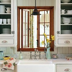 upper cabinets with drawers, wooden window frame, square porcelain sink!!!