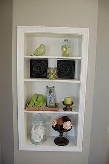 Storage cubby built in the dead space of a wall
