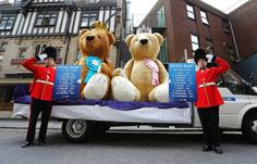 Mandatory Credit: Photo by Joe Pepler/REX Shutterstock (4736656h)  Two giant 3-metre high teddy bears, which have been created by William Hill, visit Buckingham Palace, Houses of Parliament and Saint Mary's Hospital during a tour of London today, to celebrate the imminent arrival of the second royal baby. The two bears, one boy and one girl, which are made from fur and cotton, each sport a crown and tiara respectively and display the odds of the sex of the baby on individual rosettes. The…