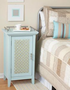 Over, under and beside  Give this handy furniture a new look by weaving coordinating ribbon onto foam-core board that gets glued to the door front. Oversize pulls screwed to the top prevent things from sliding off; they match the finish on the handle.