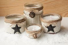 diy winter candles in glas jars decorated with old book pages, string, paper stars and pine cones